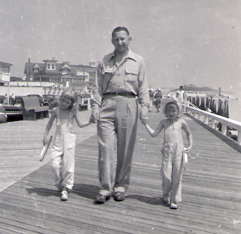 father on the boardwalk